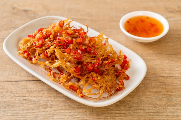 Fried enoki mushroom or golden needle mushroom with salt and chilli - vegan and vegetarian food style