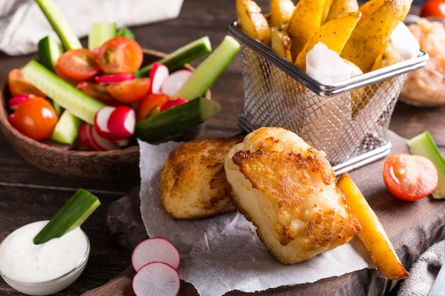 Fried fish fillet with baked potatoes