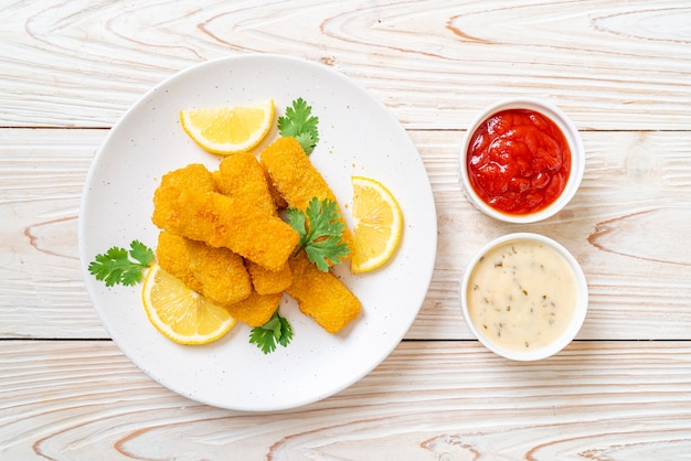 Fried fish finger stick or french fries fish with sauce