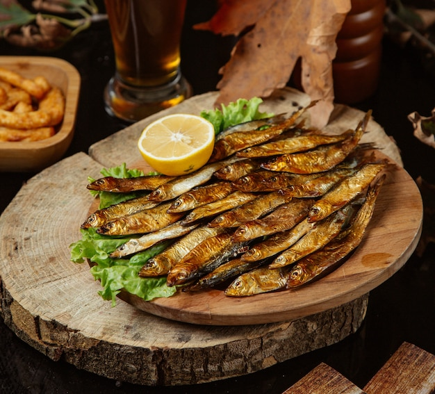 Fried fish served with lemon and lettuce