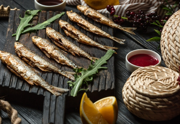 Fried fish set on wooden board