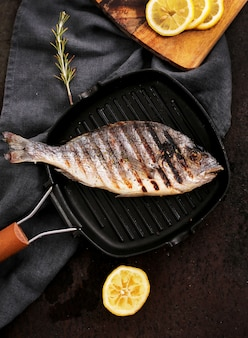 Fried fish with rosemary and lemon