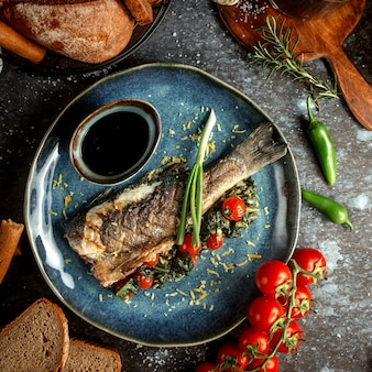 Fried fish with tomato and narsharab