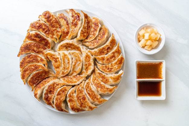 Fried gyoza or dumplings snack with soy sauce