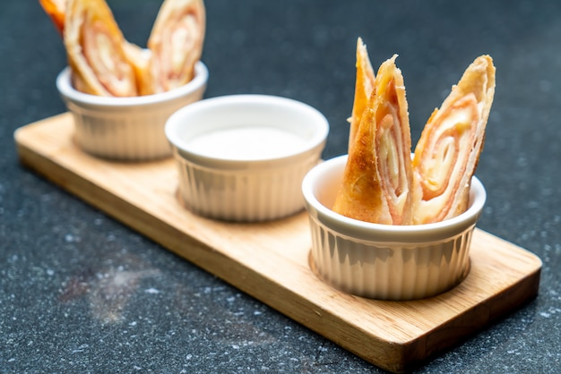 Fried ham and cheese spring rolls