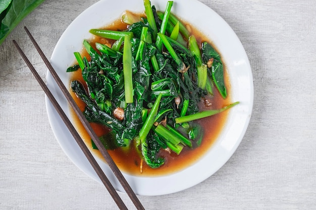 Fried kale with oyster sauce menu on wooden table