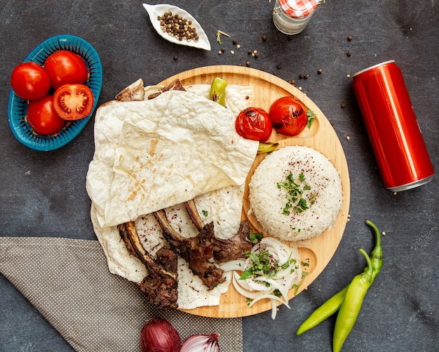 Fried lamb ribs with lavash and rice