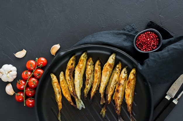 Fried mackerel in a pan.