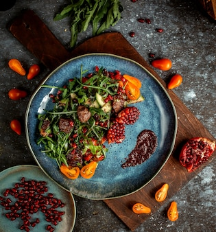 Fried meat with herbs and pomegranate