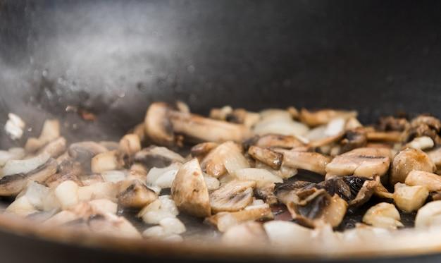 Fried mushrooms in a pan close up recipe culinary blog