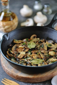Fried mushrooms with onions garlic bay leaf and dill