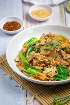 Fried noodle with pork in soy sauce and vegetable