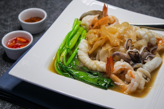 Fried noodle with sea food and kale in gravy