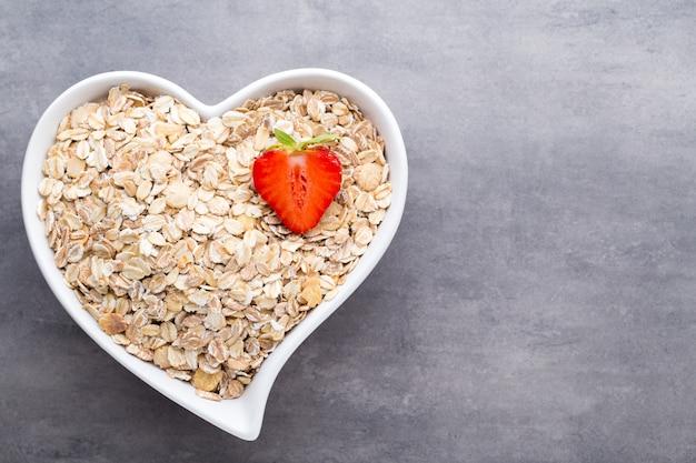 Fried oat flakes in a heart bowl.