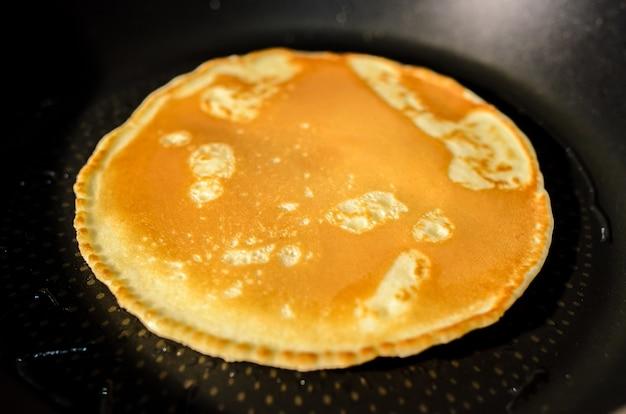 Fried pancakes in a pan