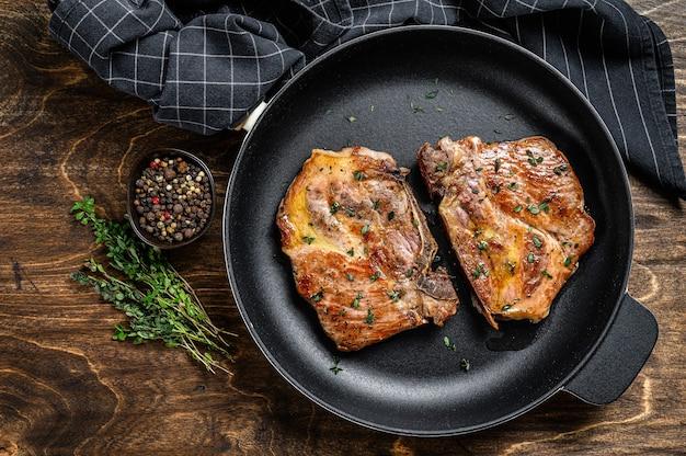 Жареные стейки из свиной корейки на сковороде