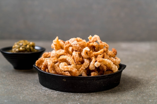Fried pork rince or pork snack with northern thai green chilli dip