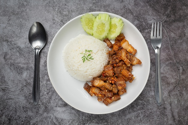 Fried pork with garlic and pepper served with rice