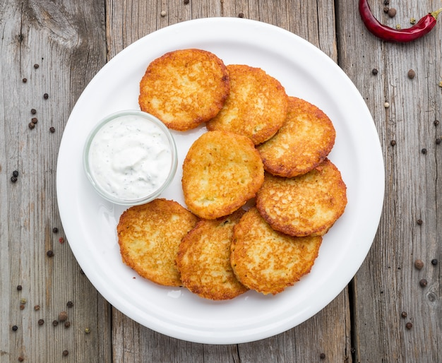 Fried potato pancakes on the old table