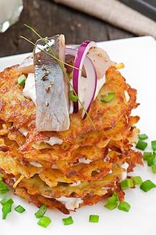 Fried potato pancakes  with herring