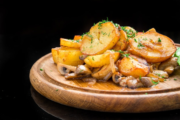 Fried potatoes with mushrooms and vegetables