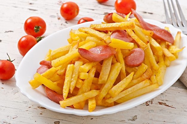 Fried potatoes with sausage on a plate