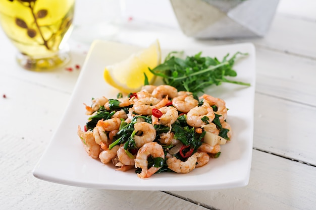 Fried prawns or shrimps with spinach