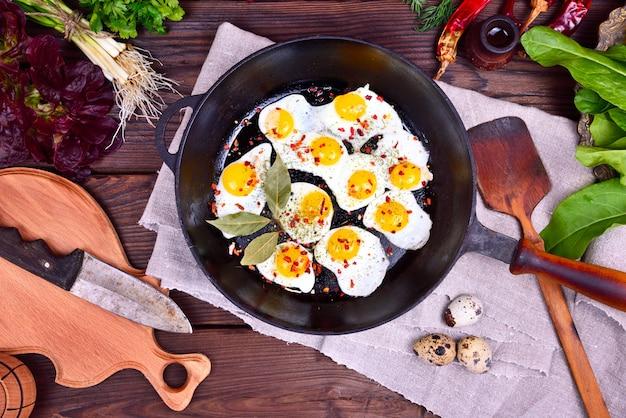 Fried quail eggs in a frying pan