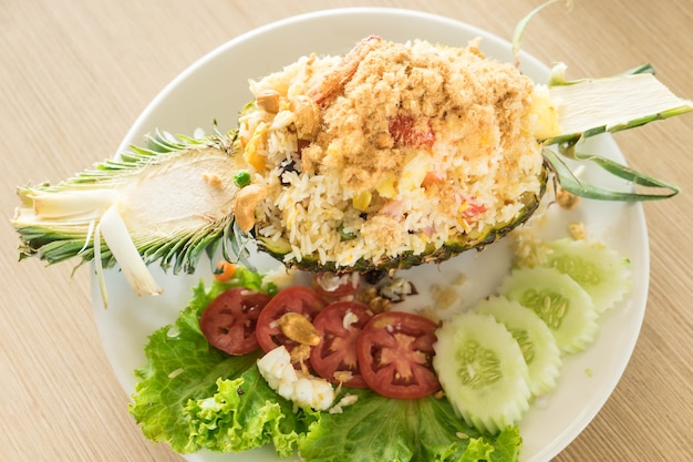 Fried rice stuffed in pineapple at a restaurant in bangkok.