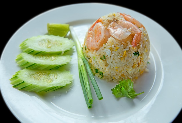 Fried rice thai style with vegetable, onion, cucumber, coriander.