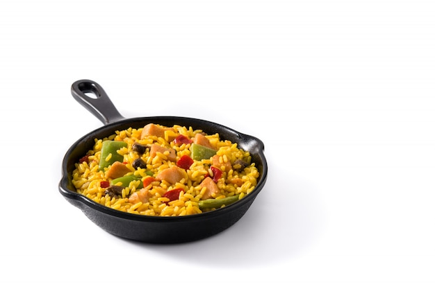 Fried rice with chicken and vegetables on frying iron pan isolated copy space
