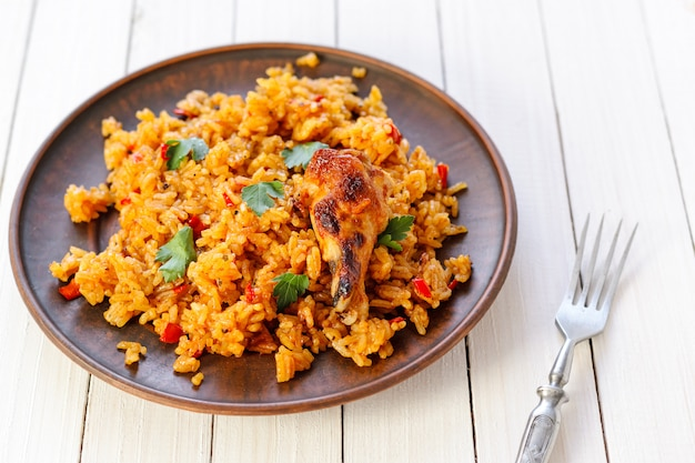Fried rice with chicken on a wooden table