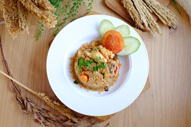Fried rice with cucumbar and tomato on the white plate