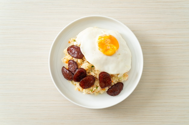 Fried rice with fried egg and chinese sausage - homemade food in asian style