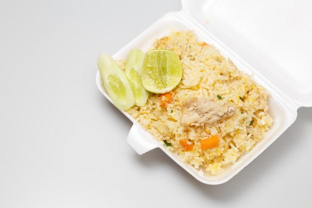 Fried rice with pork in foam box