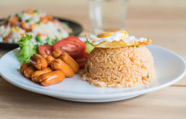 Fried rice with sausage and fried egg