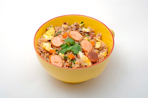 Fried rice with sausage and vegetables on white background