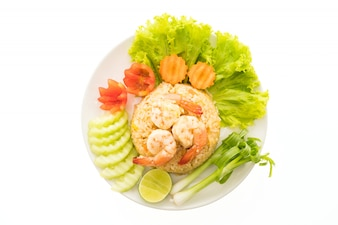 Fried rice with shrimp and prawn on top in white plate