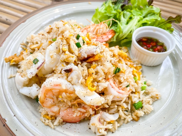 Fried rice with shrimps on plate