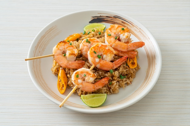 Fried rice with shrimps or prawns skewers