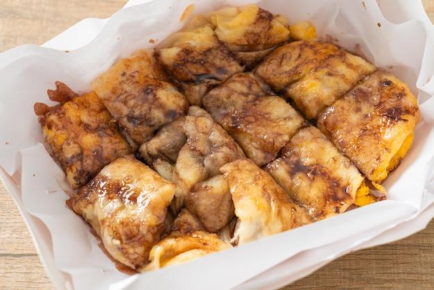 Fried roti with egg, banana and chocolate