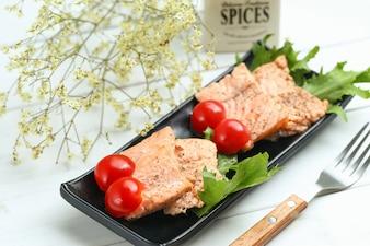 Fried salmon isolated on white background