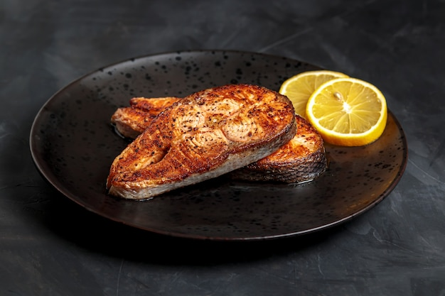 Fried salmon steak, healthy lunch dish.