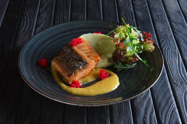 Fried salmon with mashed potato mixed with wasabi and decorated with flying fish roe