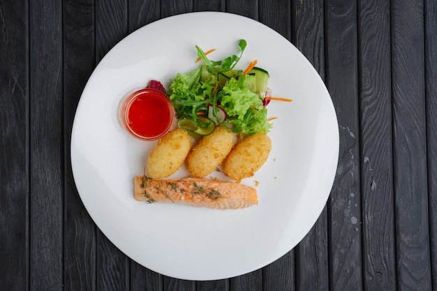Fried salmon with rice cutlet and spicy sauce