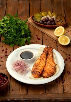 Fried salmon with side onion and sauce