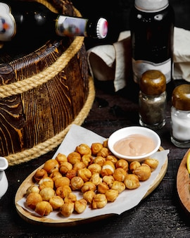 Fried salty chickpea served with spicy mayonnaise sauce