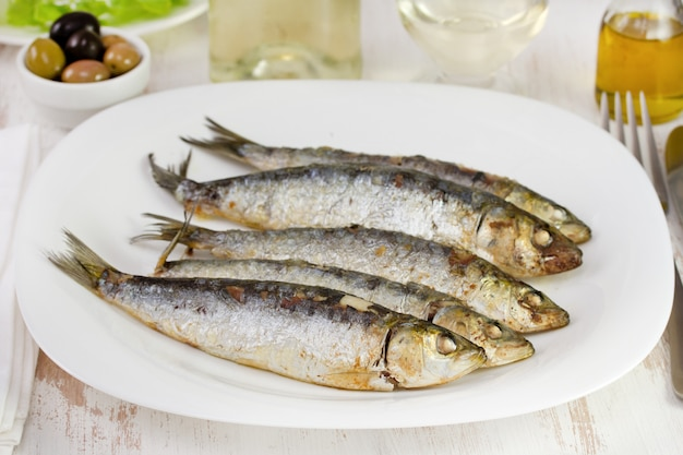 Fried sardines on the white plate