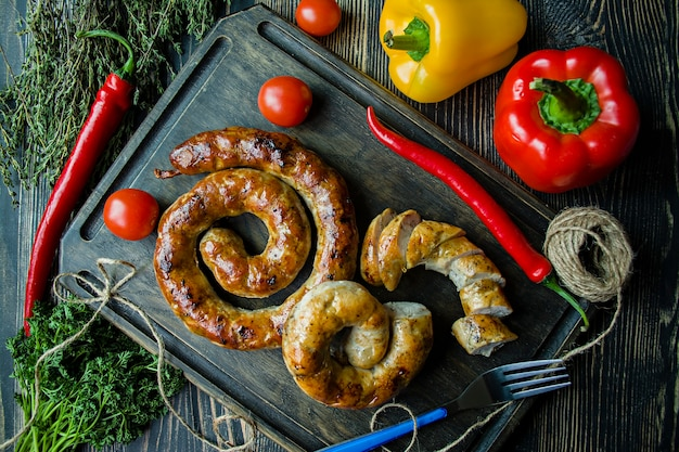 Fried sausage with herbs and spices, wooden.