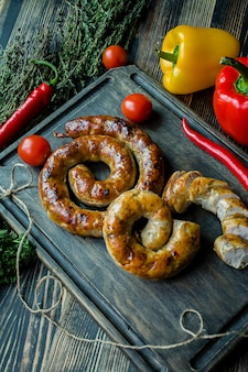 Fried sausage with herbs and spices
